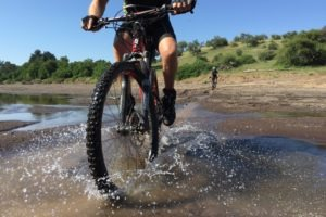 northern tuli botswana cycling safari ridign through water