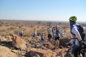 northern tuli botswana cycling safari team on hill