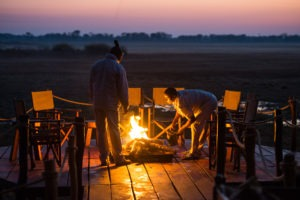 west zambia kafue Busanga Plains Camp sunset fire place