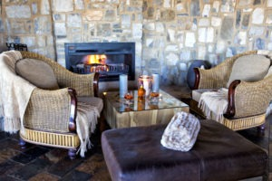 7Etosha Mountain Lodge Main area sofas fireplace