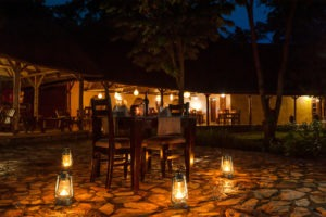 primate lodge kibale dinner outside