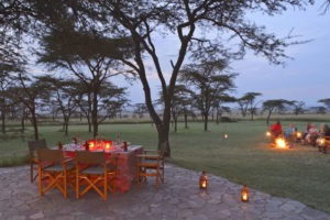 Masai Mara Topi House outdoor dinner and fire main MR