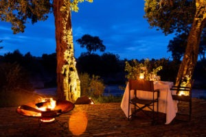 Elewana Sand River private dining by camp fire