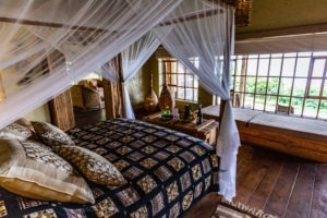 rwanda volanoes virunga lodge bed view